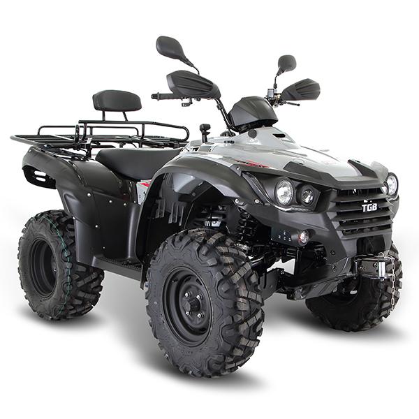 black ATV on brown soil